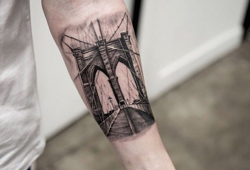 Small black ink photo like forearm tattoo of famous city bridge