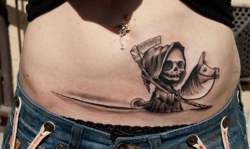 Small cartoon like grim reaper on horse belly tattoo