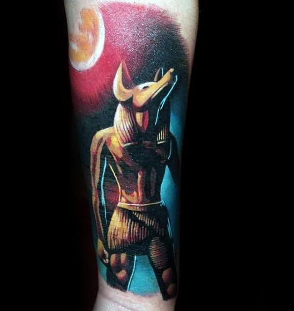 Small cartoon style arm tattoo of big Egypt God statue