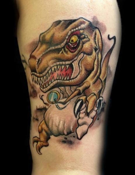 Small cartoon style interesting looking dinosaur tattoo on leg