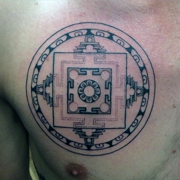 Small circle shaped chest tattoo of interesting ornament