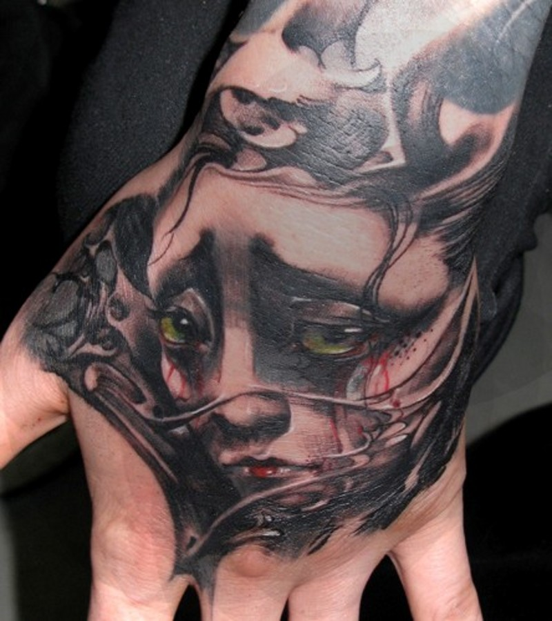 Small colored Asian geisha portrait tattoo on hand