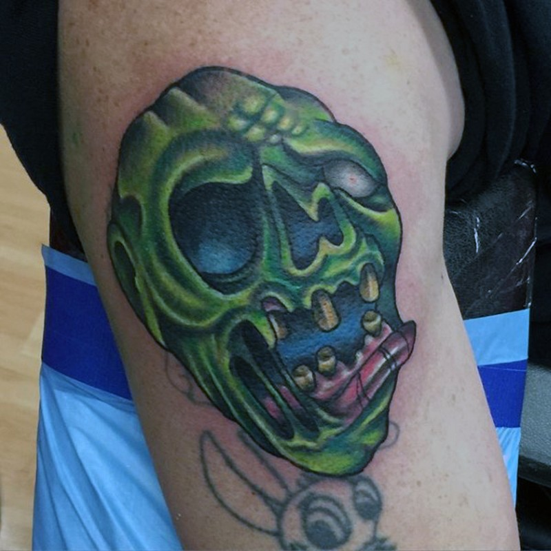 Small colored shoulder tattoo of zombie face