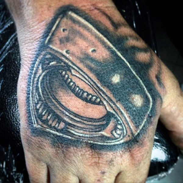 Small cool looking black ink engine part tattoo on hand