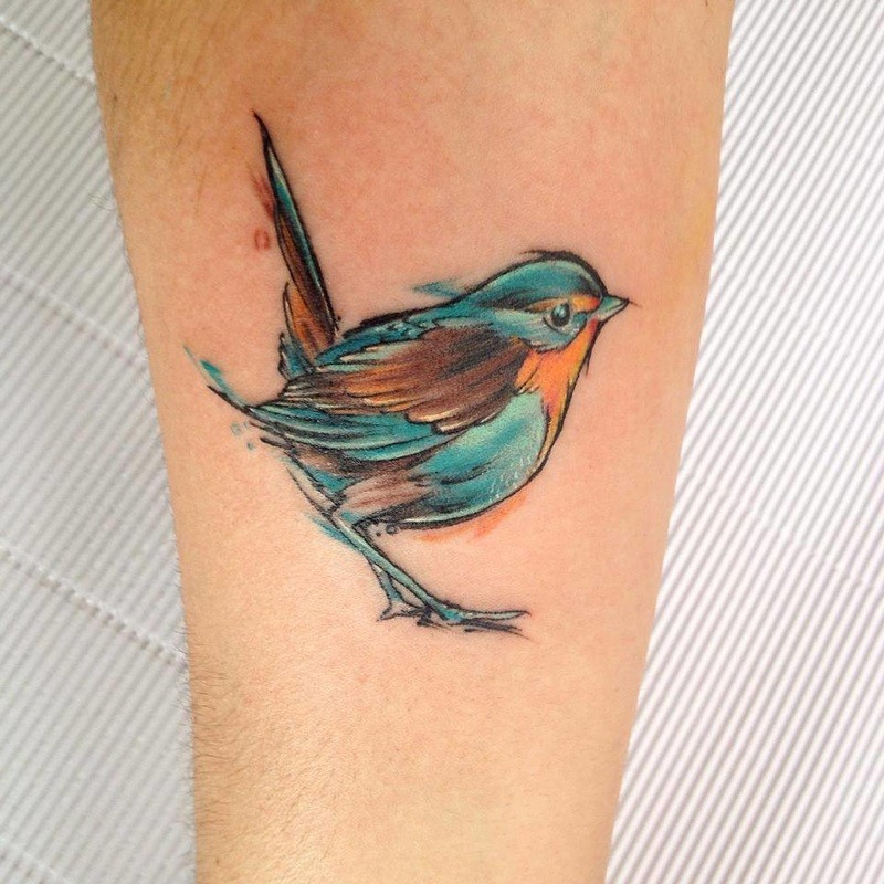 Small cute looking watercolor style leg tattoo of small bird