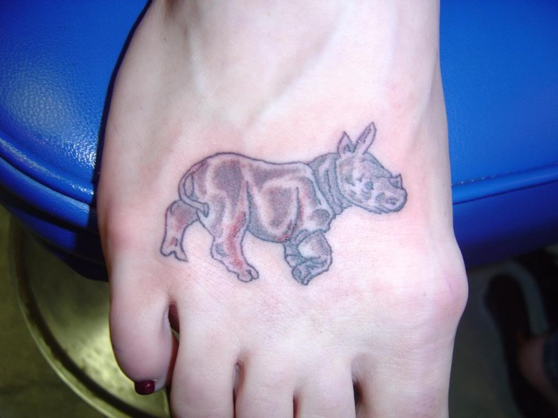 Small cute rhino tattoo on foot