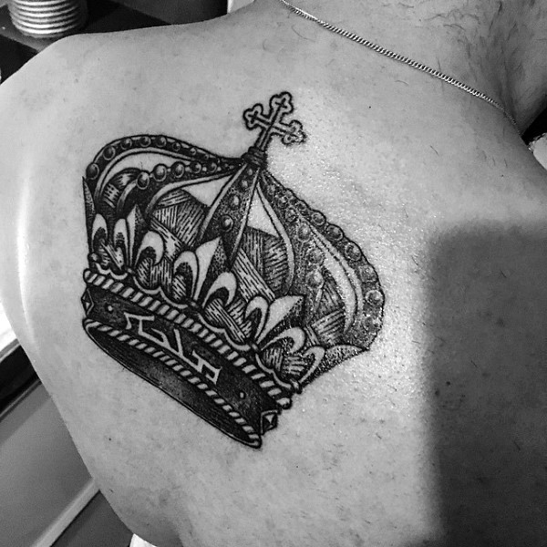 Small engraving style black ink back tattoo of beautiful crown