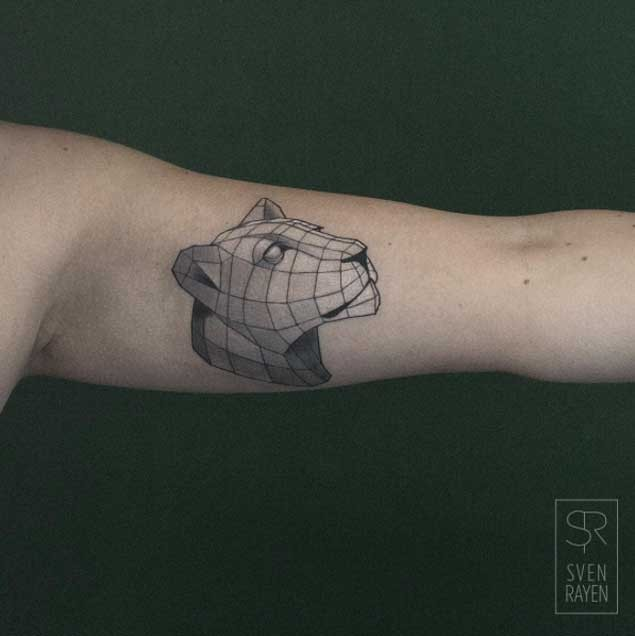 Small geometrical style biceps tattoo of lion head