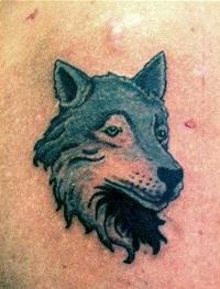Small gray wolf head tattoo