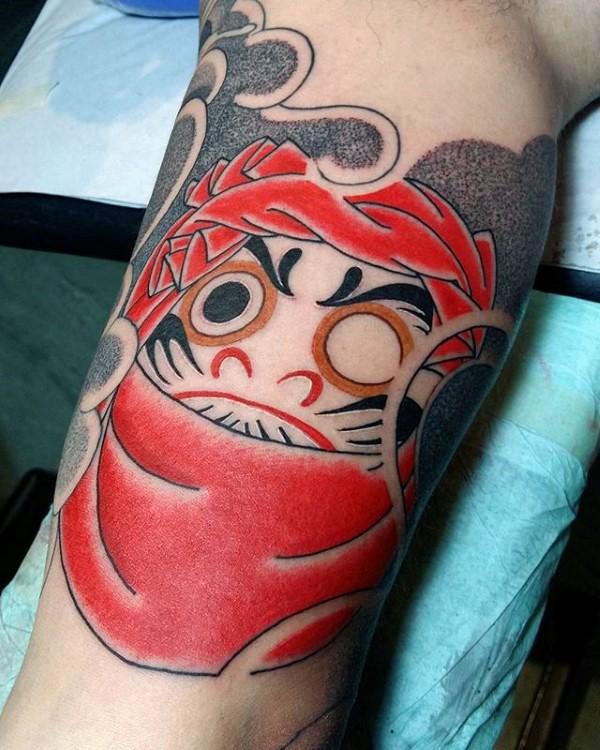 Small illustrative style biceps tattoo of daruma doll
