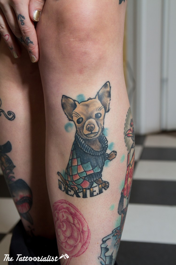 Small illustrative style colored leg tattoo of funny dog and lettering