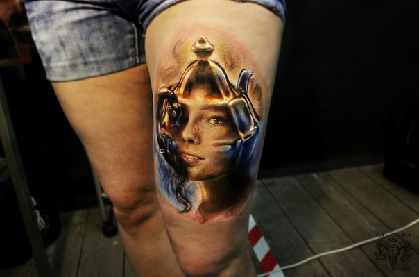 Small illustrative style colored thigh tattoo of tea pot with girls face