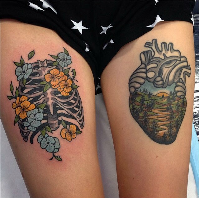 Small illustrative style thigh tattoo of human skeleton and heart