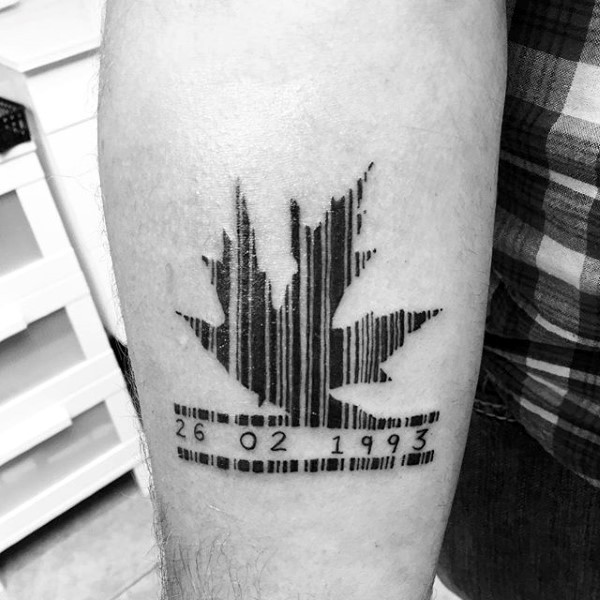 Small linework style black ink arm tattoo of maple leaf with date