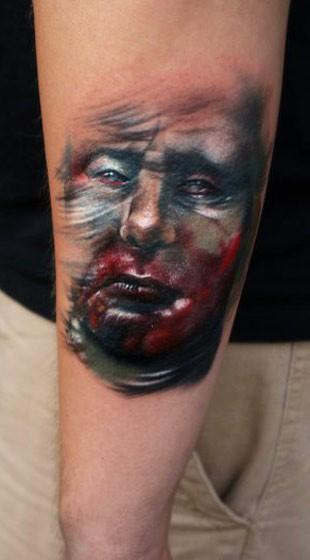 Small medium size tattoo of demonic bloody face