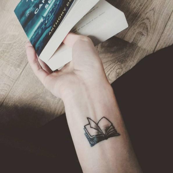 Small size open book tattoo on wrist