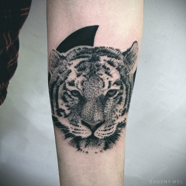 Small stippling style black ink tiger tattoo on forearm for Small tiger tattoos