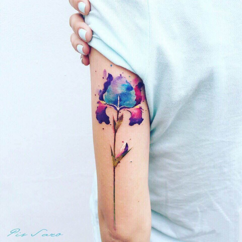 Small watercolor style arm tattoo of little flower