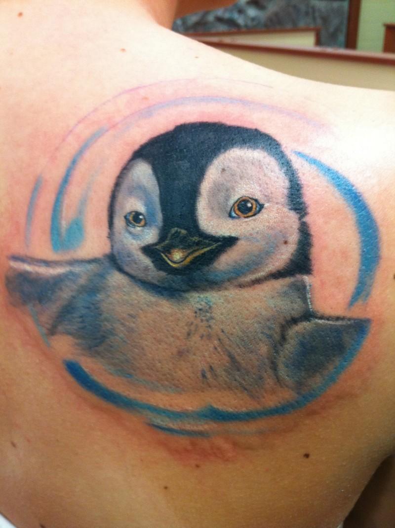 Smiling cute penguin tattoo idea