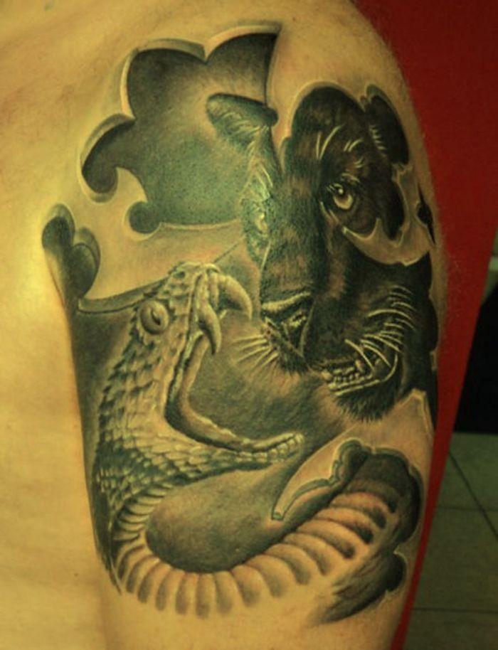 Snake and black puma tattoo on half sleeve