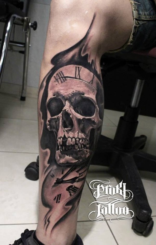 Spectacular black and gray style large leg tattoo of human skull and clock