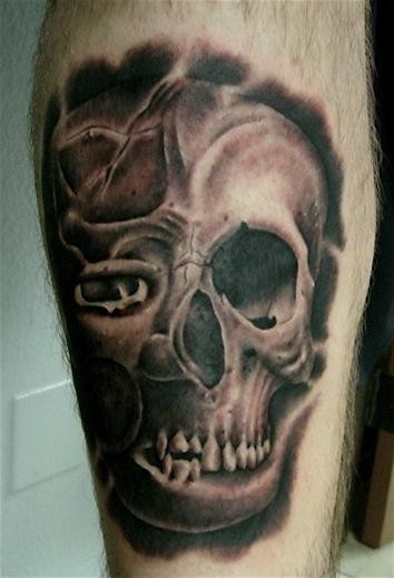Spectacular black and gray tattoo of half human half demonic skull