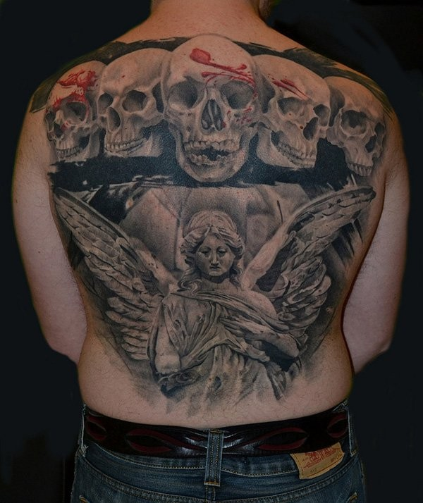 Spectacular black and white detailed whole back tattoo of angel statue and human skulls