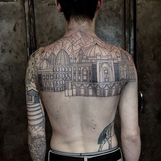 Spectacular black ink very detailed antic city tattoo on upper back with mountains