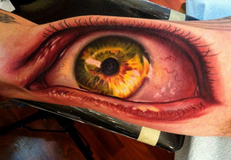 Spectacular colored biceps tattoo of creepy human eye