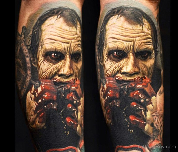 Spectacular colored horror style arm tattoo of zombie with bloody hands