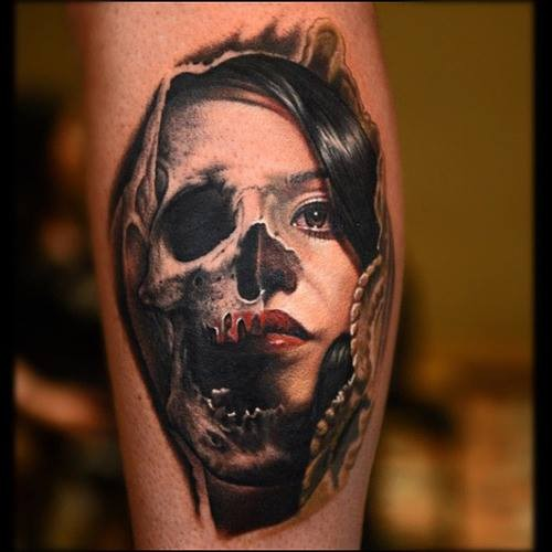 Spectacular colored leg tattoo of woman with skull