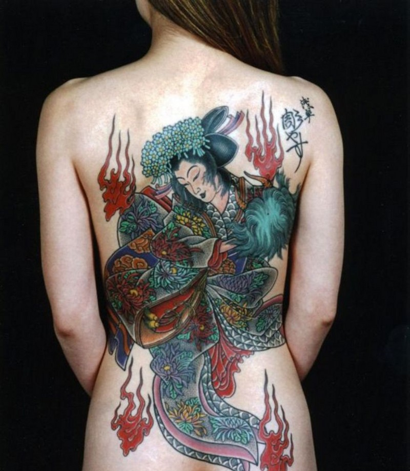 Spectacular colored massive detailed Asian dancing geisha tattoo on whole back with flames and lettering