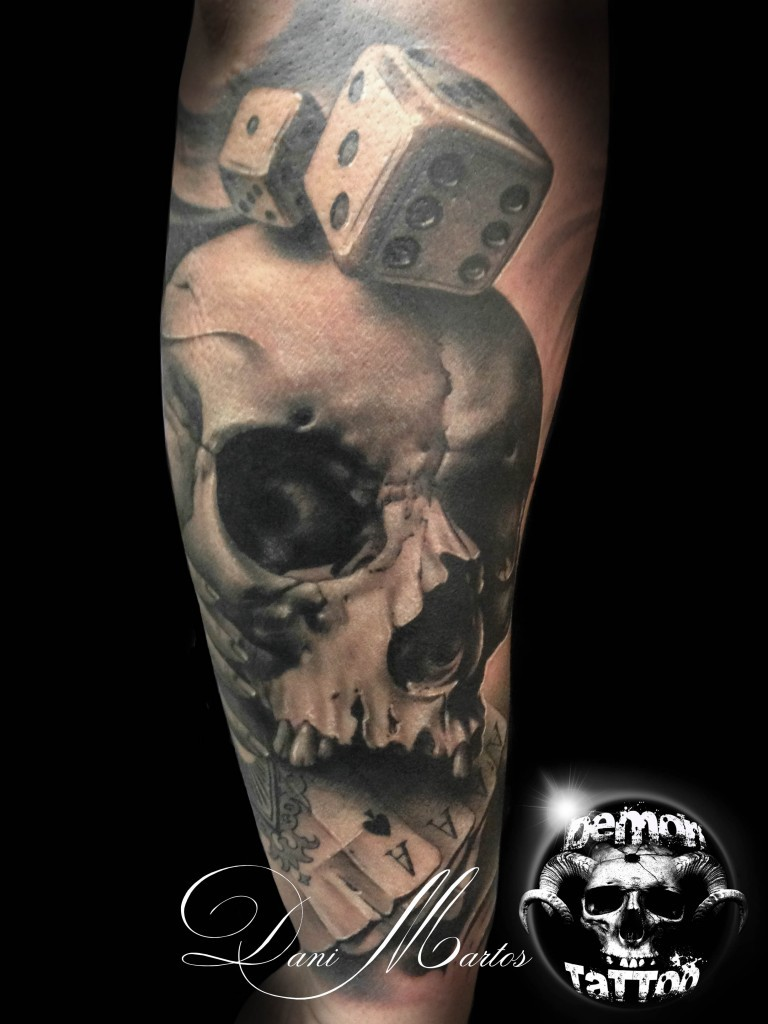 Spectacular designed and painted big detailed skull with dice and playing cards tattoo on arm
