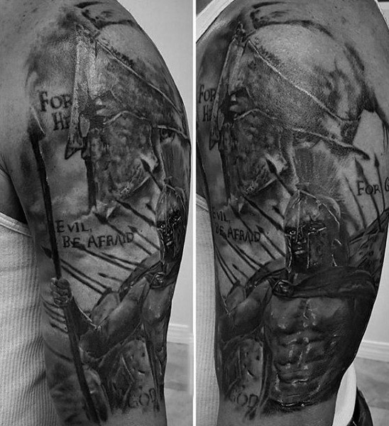 Spectacular detailed black and white spartan warrior tattoo on shoulder with lettering