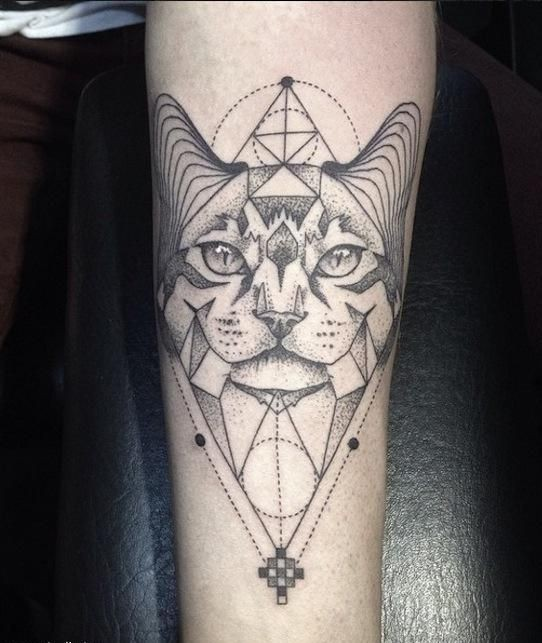 Spectacular dot style forearm tattoo of mystical cat with geometrical ornaments