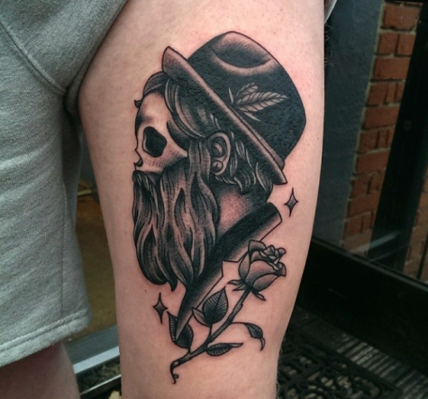Spectacular engraving style thigh tattoo of surrealism man portrait and rose