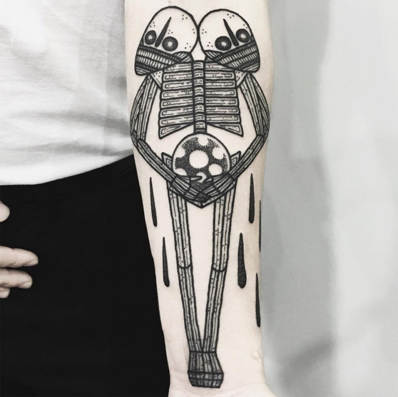 Spectacular funny looking forearm tattoo of alien with two heads