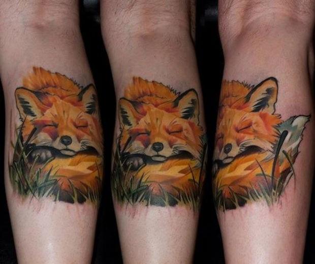 Spectacular illustrative style colored leg tattoo of sleeping fox