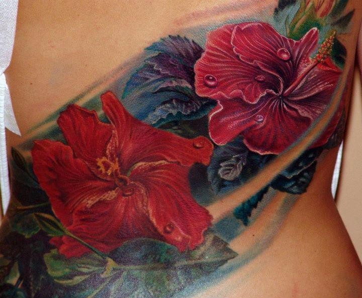 Spectacular large back tattoo of various beautiful flowers