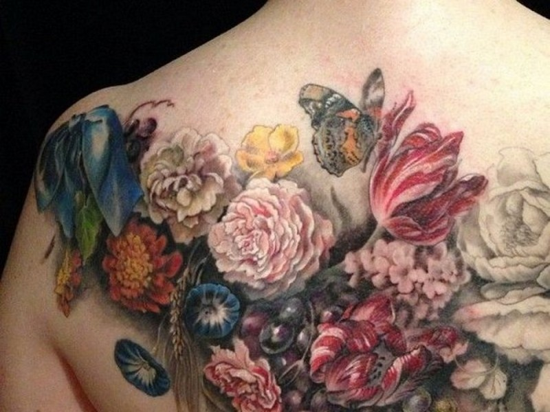 Spectacular lifelike colored various flowers tattoo on back with butterfly