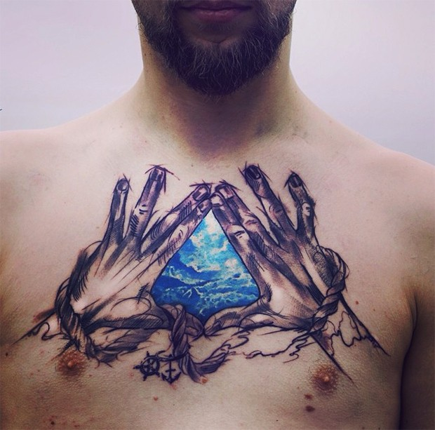 Spectacular looking colored chest tattoo of roped hands for Color chest tattoos