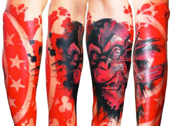 Spectacular looking colored forearm tattoo of smoking monkey and red shield