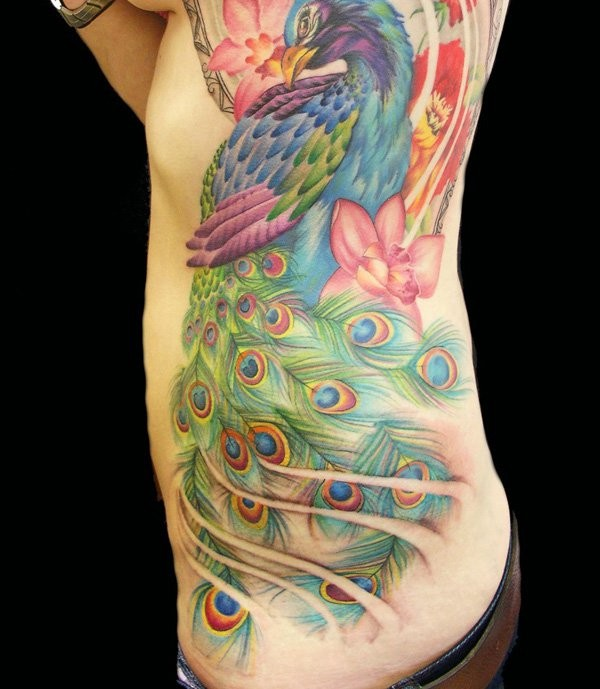 Spectacular looking colorful illustrative style large side tattoo of peacock with flowers