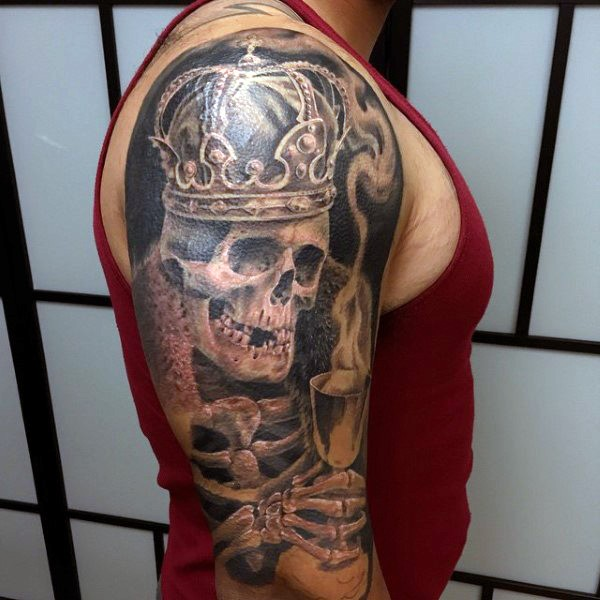 Spectacular looking shoulder tattoo of skeleton king with wine glass