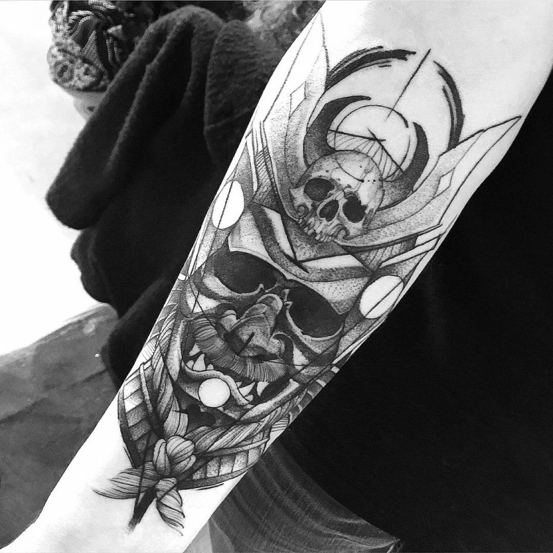 Spectacular looking stippling style black ink samurai mask tattoo on forearm