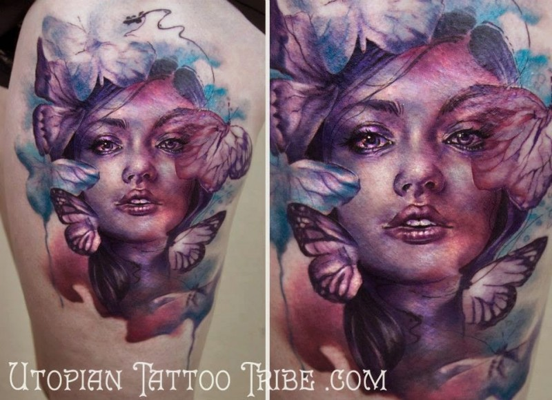 Spectacular multicolored abstract style thigh tattoo of woman with butterflies