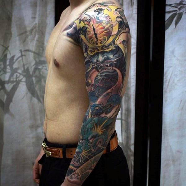 Spectacular multicolored demonic samurai mask tattoo on sleeve with green dragon