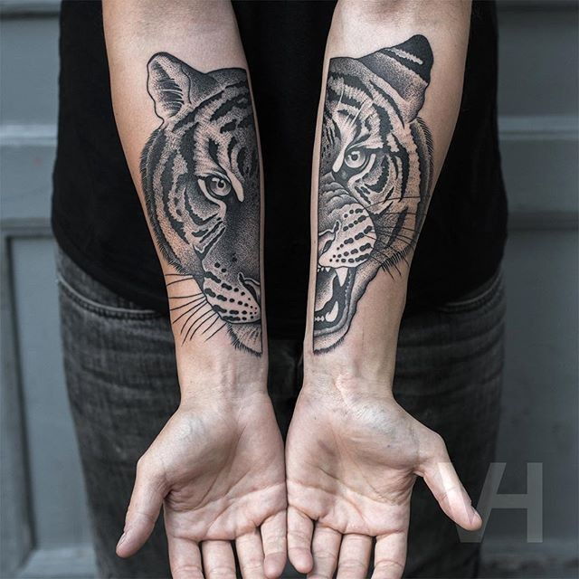 Spectacular painted by Valentin Hirsch forearm tattoo of split tiger face