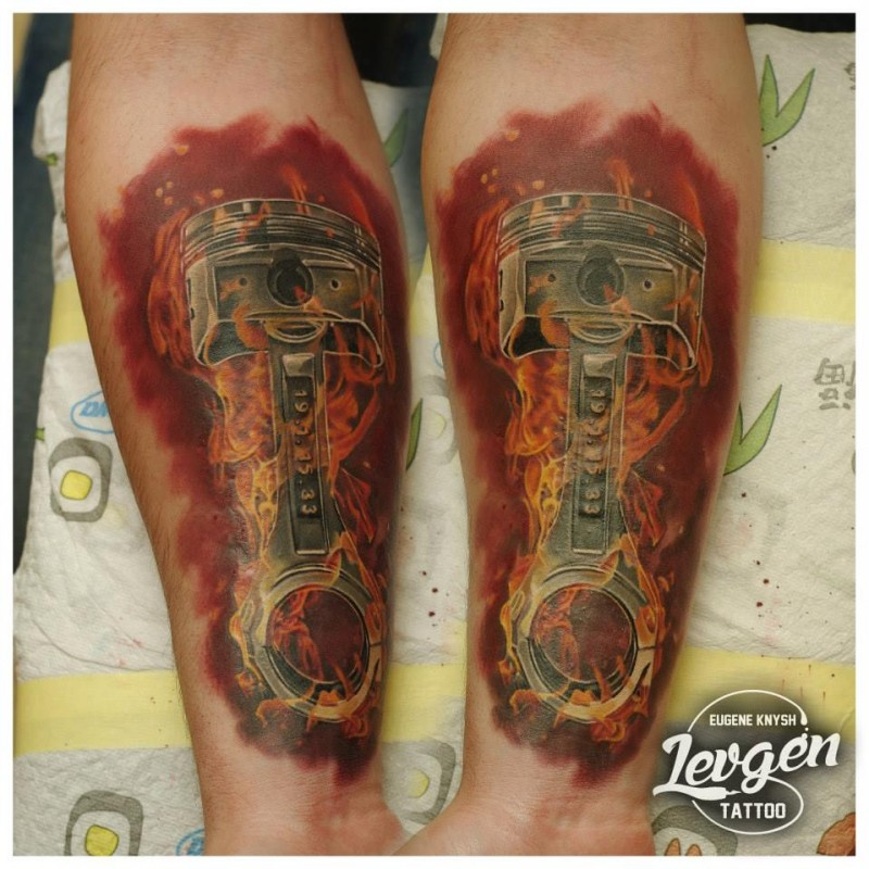 Spectacular realism style colored forearm tattoo of burning piston