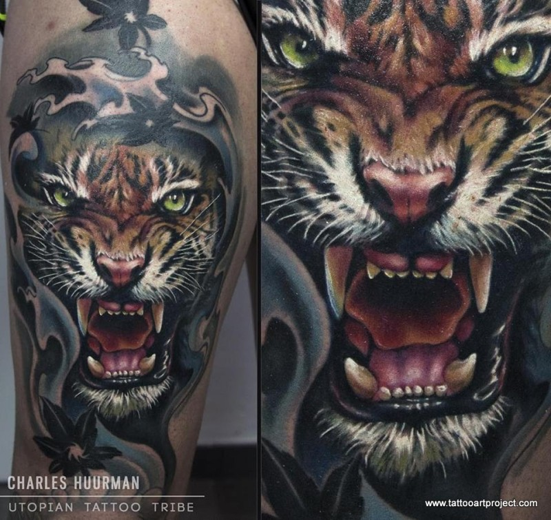 Spectacular realism style colored thigh tattoo of roaring tiger